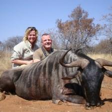 scott-janna-morcombs-with-wildebeest